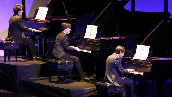 Three pianos – Six Hands – One Performance in action.