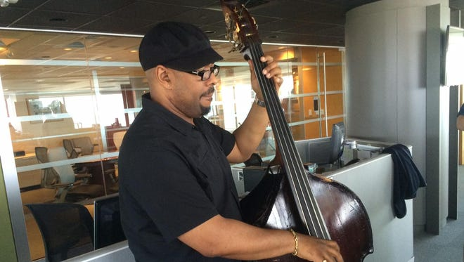 Christian McBride performs at the Burlington Free Press offices.