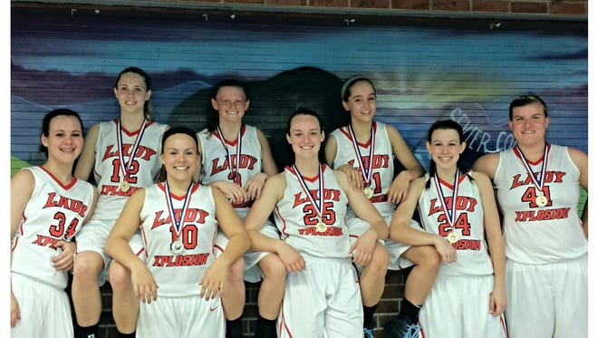 The Lady Xplosion 11th grade basketball team.