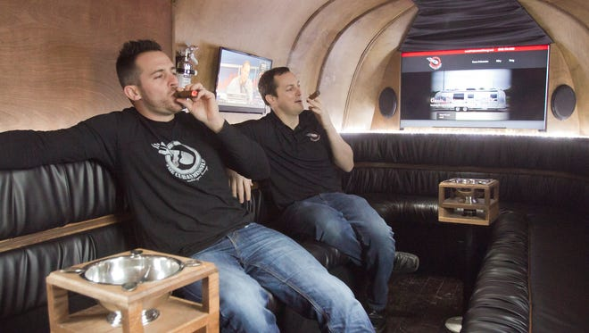 """Jason Maynard, at left, and his brother Brian applied their entrepreneurial spirit to ccnverting an Airstream trailer to a mobile cigar lounge they've given the name the """"Cuban Missile."""""""