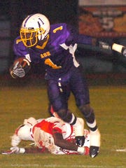 Imoan Claiborne (1) breaks a tackle en route to a long touchdown against Winnfield during his prep days at Alexandria Senior High. Claiborne was an all-state kick returner and the 2009 All-Cenla Defensive MVP as a cornerback for the Trojans.