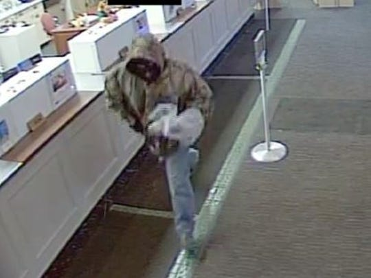 A masked gunman robbed the First Merit Bank, 1277 Ashland Road, at 12:14 p.m. today.