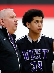 Green Bay West coach Chris Harris talks to Zane Carter (34) during a Bay Conference boys basketball game at Green Bay East on Jan. 3. Harris is in his first year as West's coach and has coached in the Green Bay Metro Basketball club for 15 years.