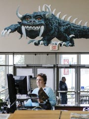 A cutout of the beast Hodag hangs above the entrance doors of the Manitowoc Public Library April 19, 2017, in Manitowoc.