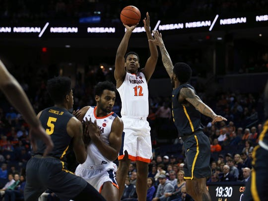 Virginia guard De'Andre Hunter (12) shoots over two Coppin State defender during the first half of an NCAA college basketball game Friday, Nov. 16, 2018, in Charlottesville, Va. (Zack Wajsgras/The Daily Progress via AP)