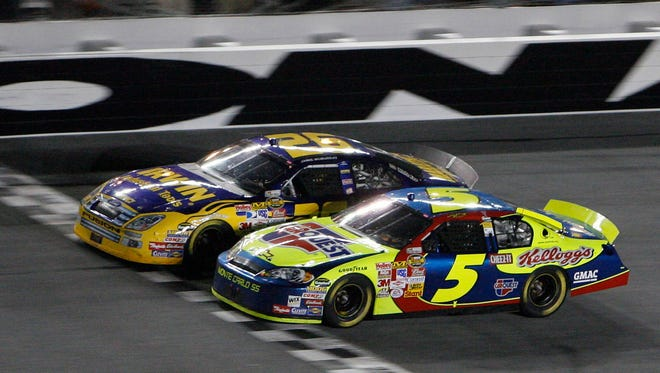 Jamie McMurray (26) edges Kyle Busch (5) at the finish line to win the Pepsi 400 on July 7, 2007.