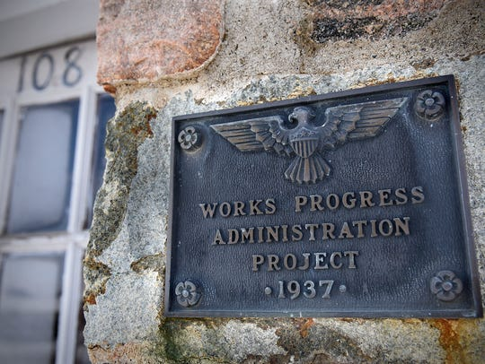 A plaque designates the fire hall in Bowlus as a WPA