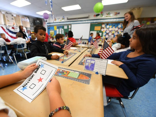 Second graders vote in a mock election in Dana McDonough's