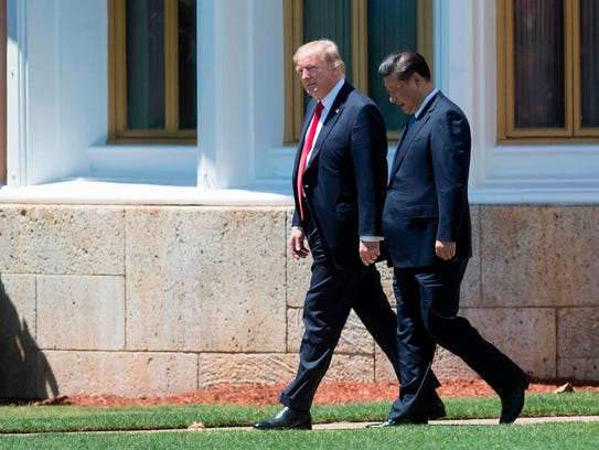 President Trump and Chinese President Xi Jinping walk