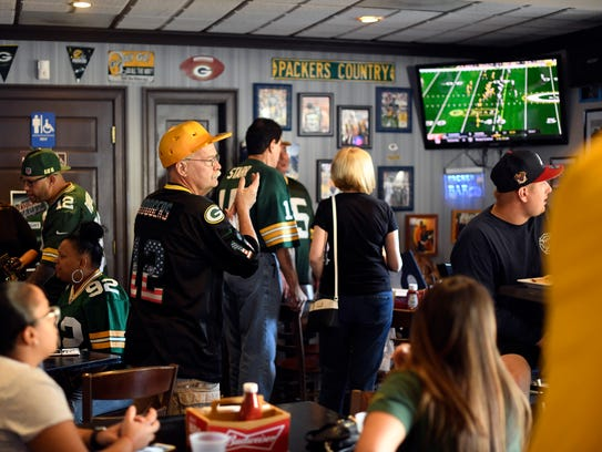 Green Bay Packers fans watch the season opener against