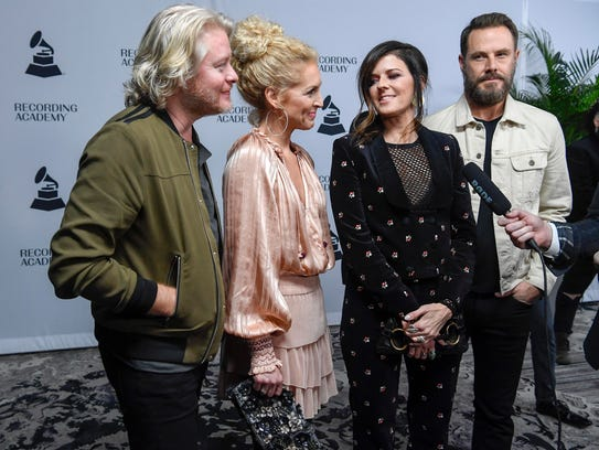 Members of Little Big Town talk with reporters as they