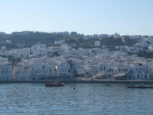 Mykonos, Greece, sits lovely in the distance.
