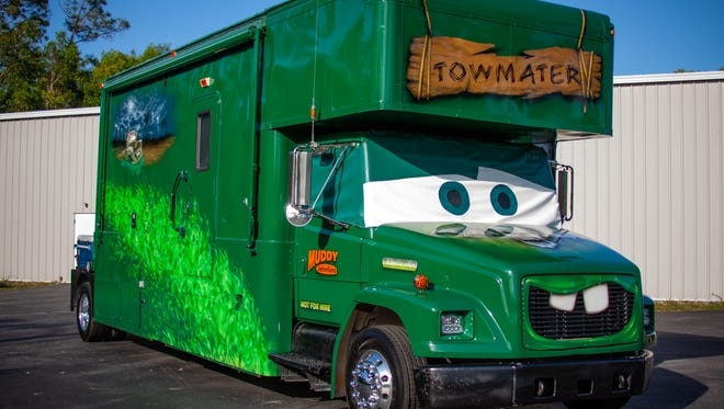 "This 31-foot Toy Hauler RV was painted to look like Tow Mater, the character from the ""Cars"" movies. It's owner, Jack Evans, will display it this weekend at Six Bends' Florida Automotive and Motorsports Expo (FAME)."