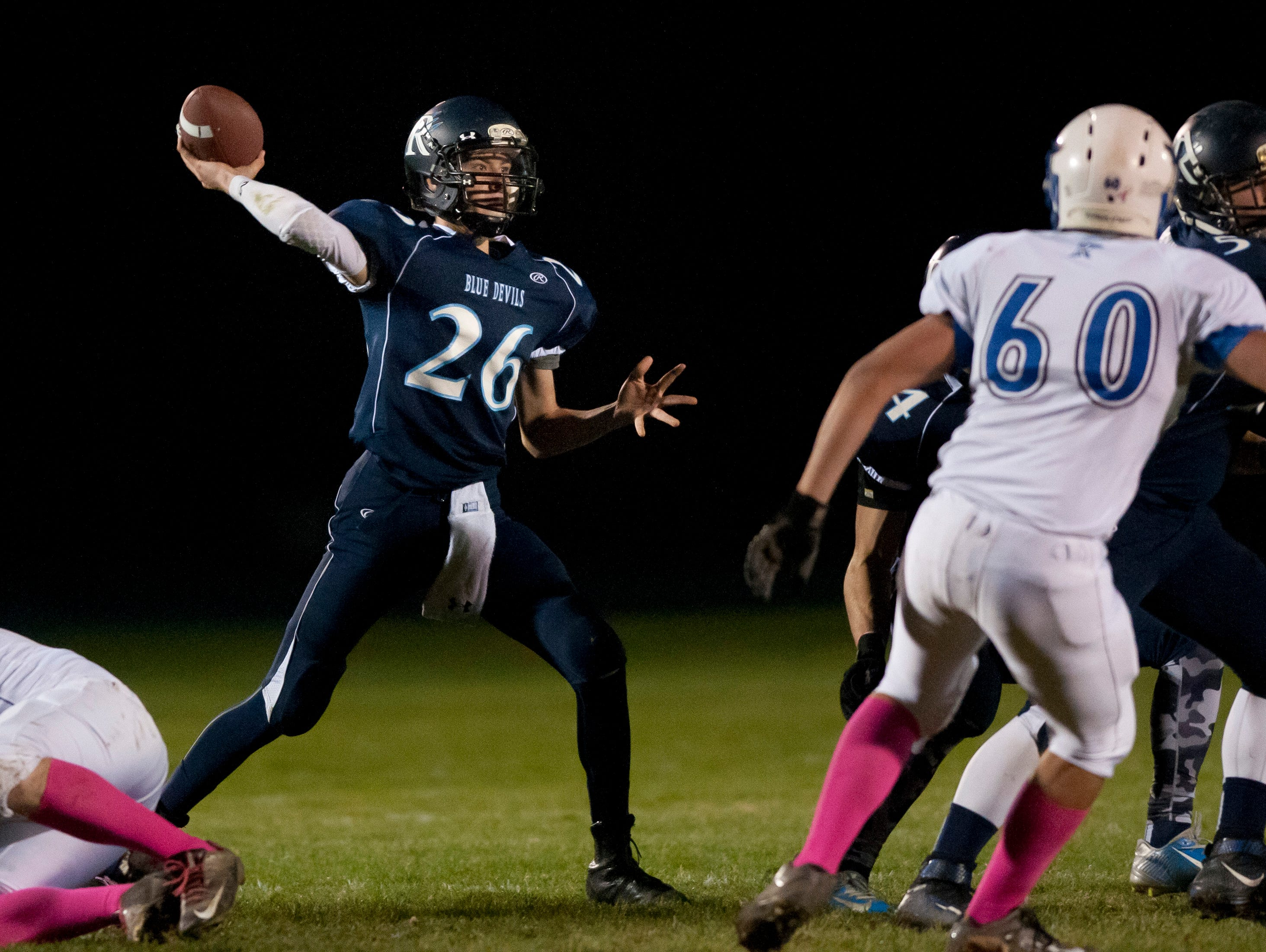 Richmond's Chase Churchill throws a pass during a football game Friday, October 30, 2015 at Richmond High School.