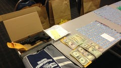 Police seized cash and drugs from a vehicle they pulled over during a traffic stop in Wilmington.