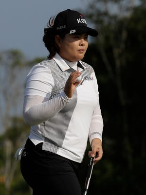 Inbee Park of South Korea walks away after putting on the 13th hole during the third round of the women's golf event.