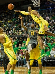 Ducks forward Kenny Wooten rejects a shot by ASU guard Shannon Evans on Thursday.