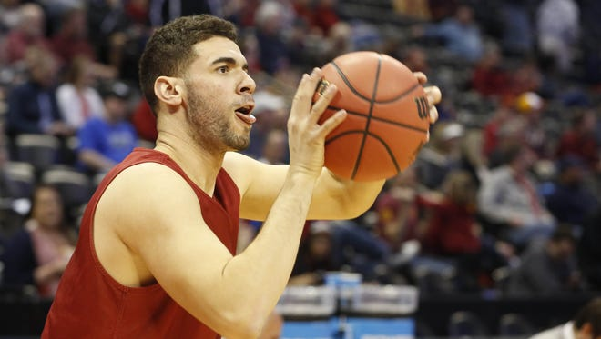 Iowa State forward Georges Niang (31) takes a shot Wednesday, March 16, 2016, during practice in Denver.