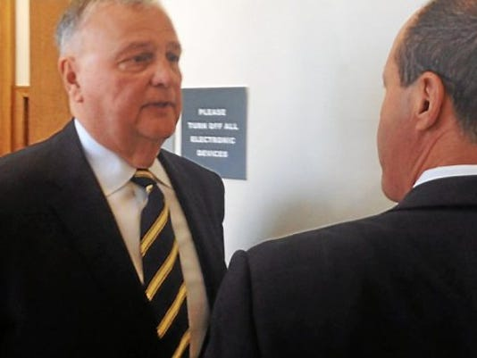 Robert Kerns, left, speaks to his lawyer, Brian McMonagle, after a court hearing in Norristown Friday, May 15, 2015. During the hearing, a judge declared Kerns to be a sexually violent predator, based on findings of the Pennsylvania Sexual Offenders Assessment Board. Kerns ill have to register as such with the Pennsylvania State Police for the rest of his life.