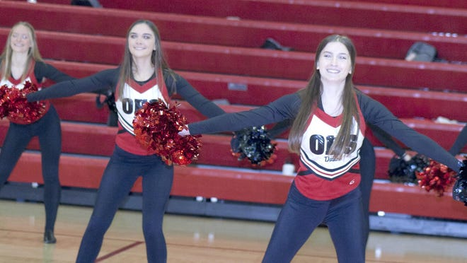The Ottawa High School dance team, the Cyclonettes, performed at halftime of the boys and girls basketball games Friday in the OHS gym. [PHOTO BY GREG MAST/THE OTTAWA HERALD].