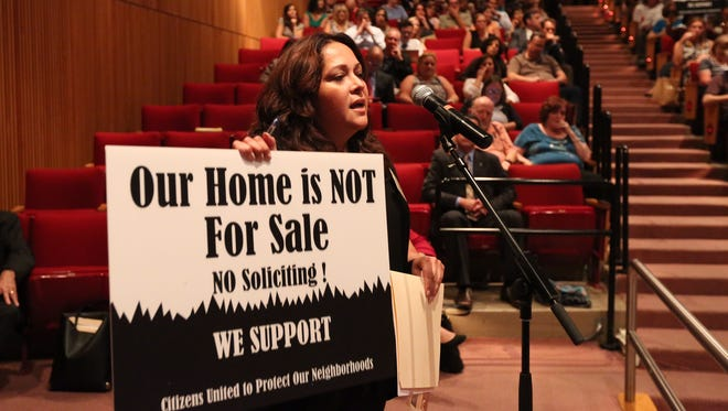 Claudia Gollub of Chestnut Ridge speaks during a public meeting on blockbusting at Rockland Community College, Sept. 21, 2016.
