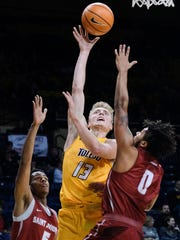 Reitz grad Jaelan Sanford goes up for a basket in a Toledo game earlier this season.