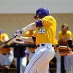 LSU's Kade Scivicque (22) hits the ball during an SEC game. LSU will host an NCAA Regional for the 23rd time.