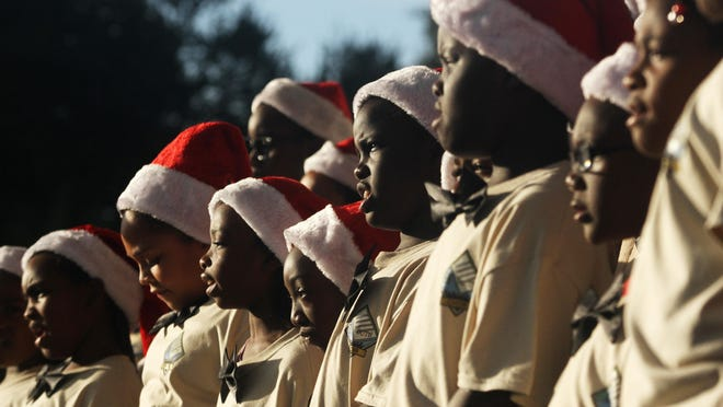 The Housing Authority Choir performs at the tree lighting celebration in Clemente Park in Fort Myers.