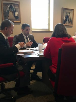 The City of Jackson Budget Review Committee discussing the stormwater utility fee at Wednesday's meeting at City Hall.