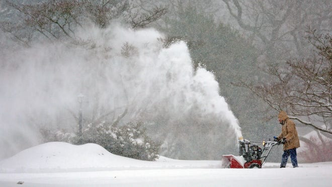 Mark Pilnick got out the snow blower to start clearing snow off his driveway on Old Hill Rd. in Sedgley Farms on Saturday morning.
