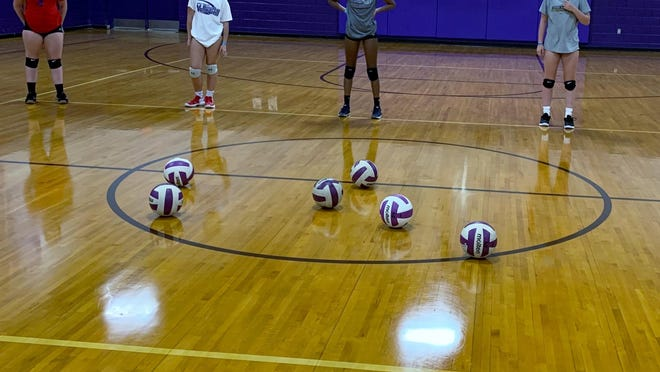 North Henderson High volleyball players work on drills Tuesday at Tom Pryor Gymnasium.