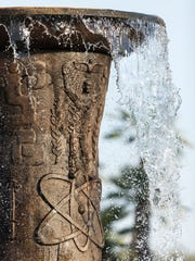 Water cascades over the atomic symbol representing Mexico's participation in the scientific and technological modern world. The male figure exposing his organs and arms in a non-resistant stance, symbolizes a complete dedication to peace and an offer of Mexico's friendship to the world.