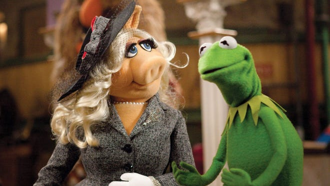 The Muppets' Miss Piggy and Kermit during better times.