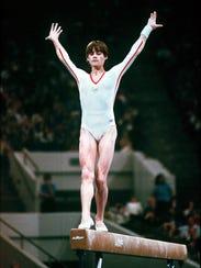 Romania's top gymnast, Nadia Comaneci, performs on