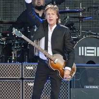 Paul McCartney performs during Lollapalooza in Chicago on July 31. McCartney will be in concert Oct. 13 at Nationwide Arena in Columbus