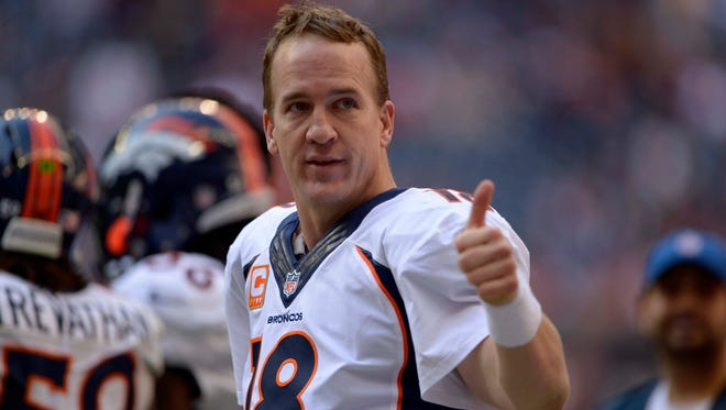 Denver Broncos quarterback Peyton Manning (18) gives a thumbs up to cheering fans against the Houston Texans during the second half at Reliant Stadium. The Broncos won 37-13 as Manning set an NFL record with 51 touchdown passes in a single season.