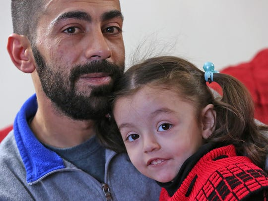 Syrian refugee Abdul Sater Khaled Assaf, his daughter,