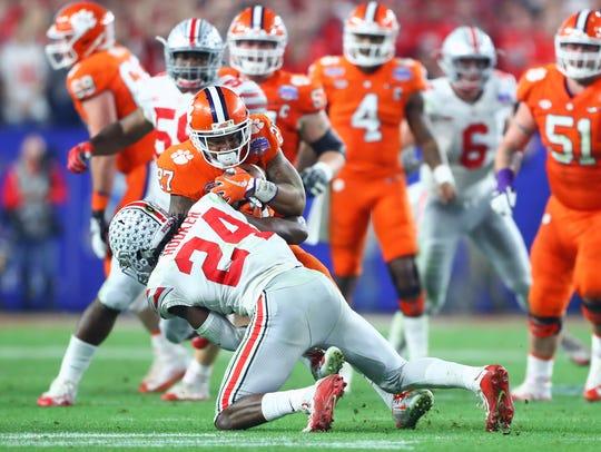 Ohio State safety Malik Hooker tackles Clemson  running