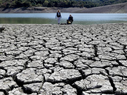 Cracks appear in the dry bed of the Stevens Creek Reservoir in Cupertino, Calif., in March.