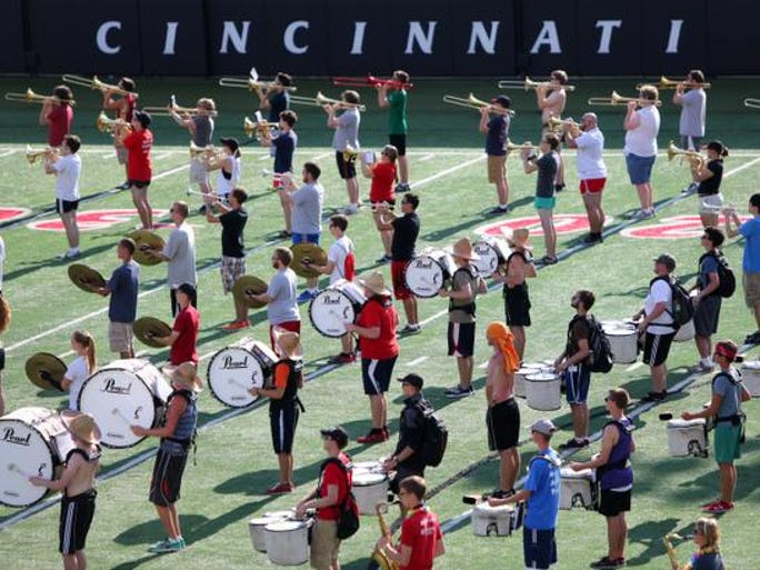 Members of the University of Cincinnati Marching Band rehearse at Sheakley Athletic Complex. The band is getting ready for their opening game on September 12. Due to current renovation at Nippert Stadium, all home football games will be held at Paul Brown Stadium. The band is under the direction of Dr. Terren Frenz. He is the 13th director since 1920, when the band was part of the ROTC.