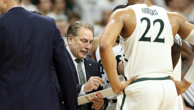 Feb 11, 2017; East Lansing, MI, USA; Michigan State Spartans head coach Tom Izzo talks to his team during the second half against the Iowa Hawkeyes at the Jack Breslin Student Events Center.