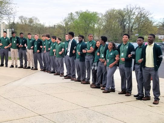 Camden Catholic High School students stand in support