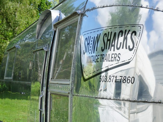 Brad Taylor turned his hobby into a business called Shiny Shacks, which offers restoration, remodel and repair services for vintage trailers. His logo adorns this 1959 Airstream Overlander.