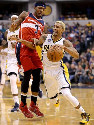 Indiana Pacers guard George Hill (3) is fouled by Washington Wizards guard Bradley Beal (3) in the first half of their game Friday, Jan 15, 2016, evening at Bankers Life Fieldhouse.