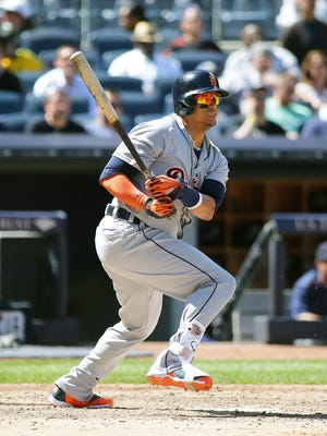Tigers designated hitter Victor Martinez (41) hits an RBI ground out in the fifth inning of the Tigers' 4-1 win Sunday at Yankee Stadium.