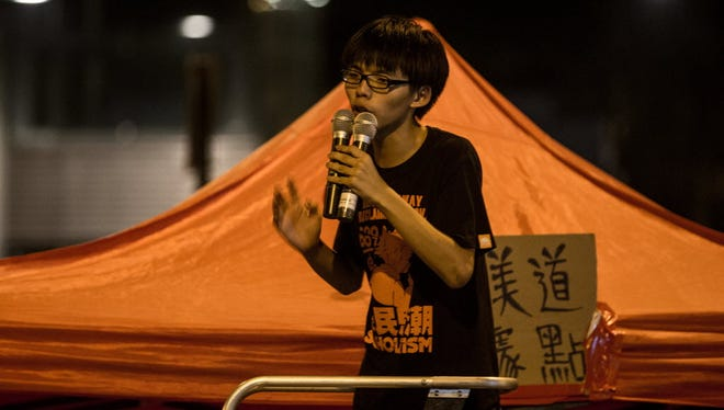 17 year-old student protest leader Joshua Wong speaks to fellow students on the street outside the Hong Kong Government Complex on Oct. 1, 2014.