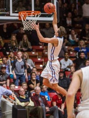 Dixie's Tyler Bennett goes up for dunk during the game against Bear River in Friday's 3A semifinal matchup at the SUU Centrum, Feb. 26, 2016.