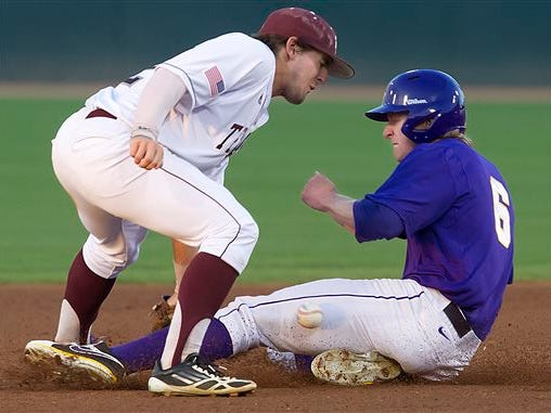The ball hits LSU's Andrew Stevenson on the leg as he slides safely into second past Texas A&M's Ryne Birk on a steal during a game earlier this season.