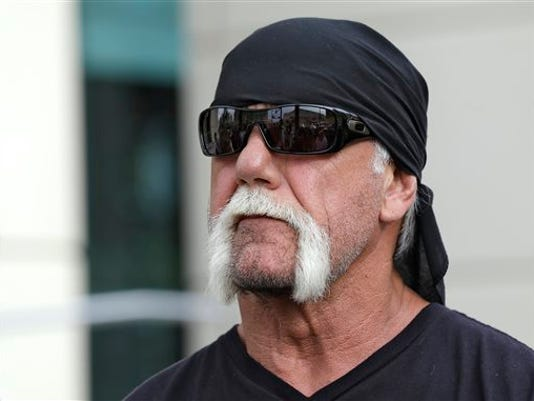 FILE - In this Oct. 15, 2012, file photo, reality TV star and former pro wrestler Hulk Hogan, whose real name is Terry Bollea, looks on as his attorney speaks during a news at the United States Courthouse in Tampa, Fla. Hogan is suing Gawker for invasion of privacy, after the New York-based website published a tape of Hogan having sex with his then-best friend's wife. The trial starts Monday, July 6, 2015. (AP Photo/Chris O'Meara, File)