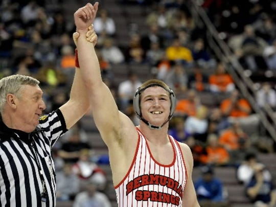 Bermudian Springs' Tristan Sponseller's hand is raised after he defeated Corry's Ryan Morris in the PIAA Class AA 195-pound championship bout on Saturday, March 8, 2014 at the Giant Center. (Chris Dunn -- York Daily Record)